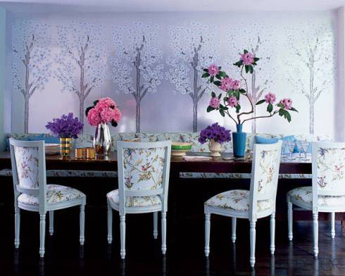 Cynthia Rowley's dining room. The dining area's chairs, banquette, and bolsters are covered in a Cole & Son cotton; the wall covering was designed by Rowley. via ElleDecor