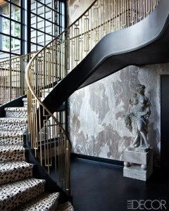 A brass staircase railing designed by Kelly Wearstler in the home she designed for Lara and Jeff Sanderson.  ELLEDECOR.com