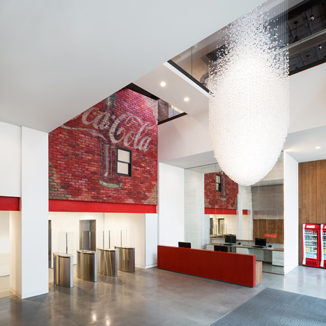 Coca Cola London headquarters  designed by UK studio MoreySmith that includes a wall of 5,000 recycled drink bottles
